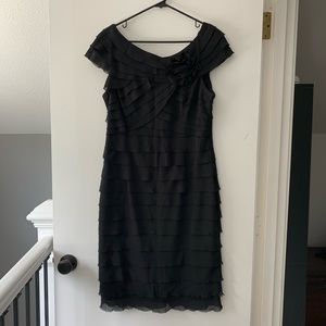 NWOT. Black knee-length cocktail dress.